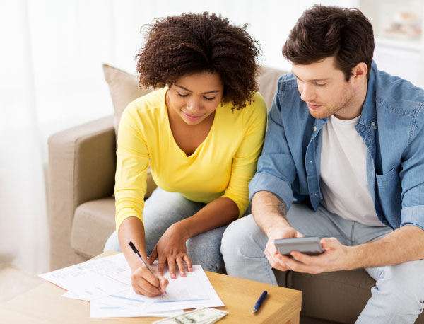 couple filling out financial paperwork