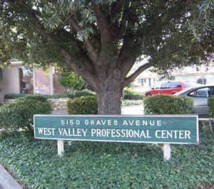 West Valley Professional Center, 5150 Graves Avenue Sign with a tree and cars in the background