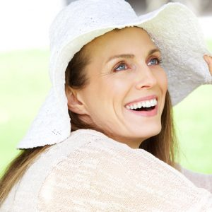 relaxed woman in hat