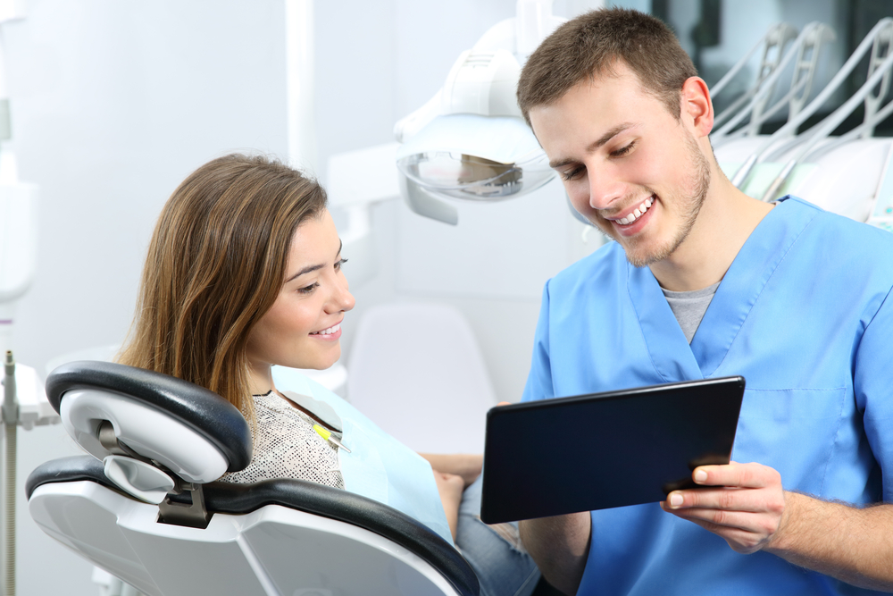 dentist consulting with patient